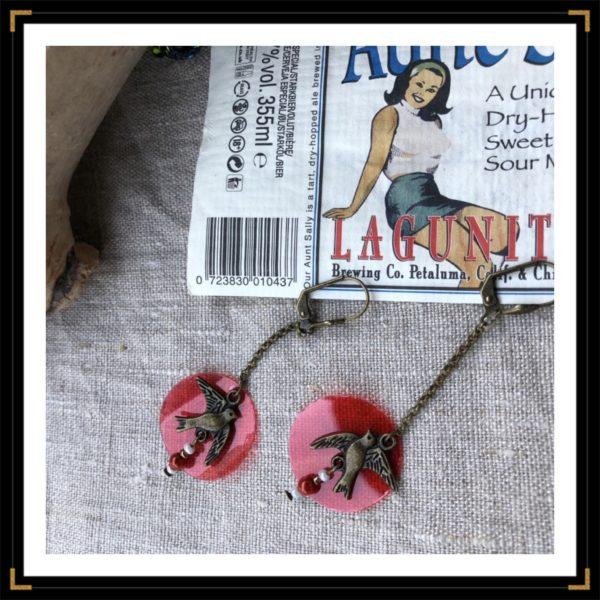 Zhirondelles BO bronze plastique rouge pose