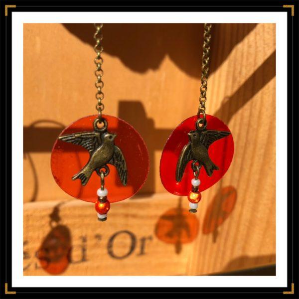 Zhirondelles bronze plastique rouge